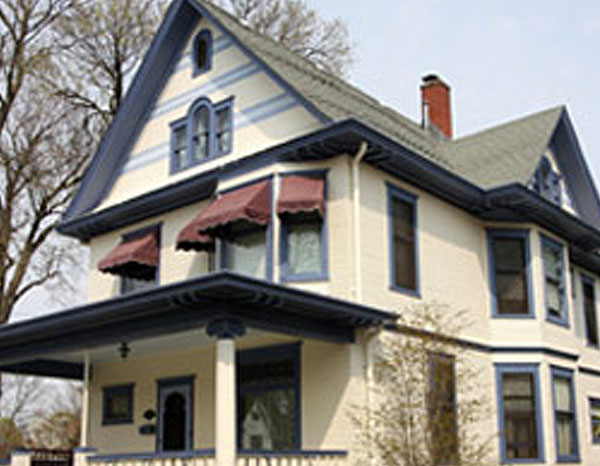 beige house with blue trim, exterior