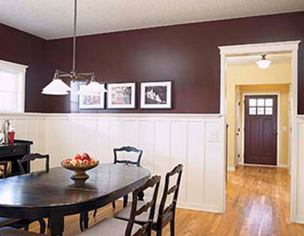 burgundy walls with white, brown table, wooden floors