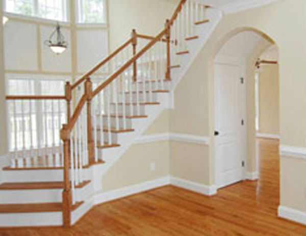 white staircase and wooden steps and railing and wooden floor