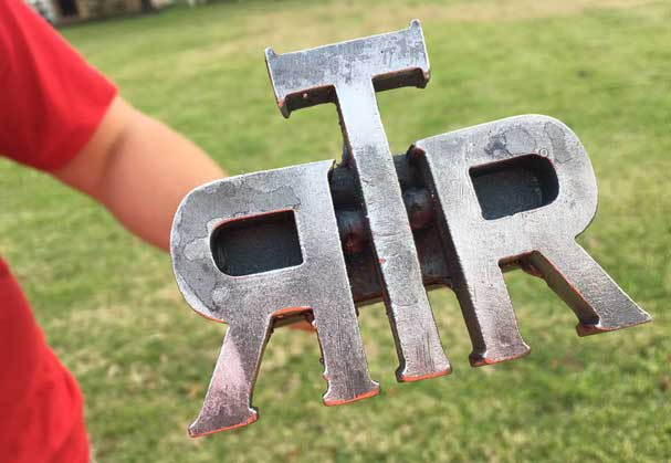 TRR-Person-holding-RTR-monogram