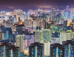 Crowded city at night illustrating how humans have multiplied but not replenished the Earth, leading to mineral and trace mineral deficiency