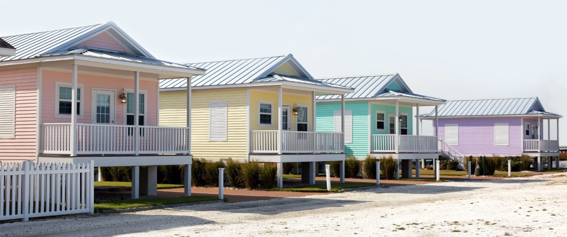 Colorful pastel summer rental cottages.