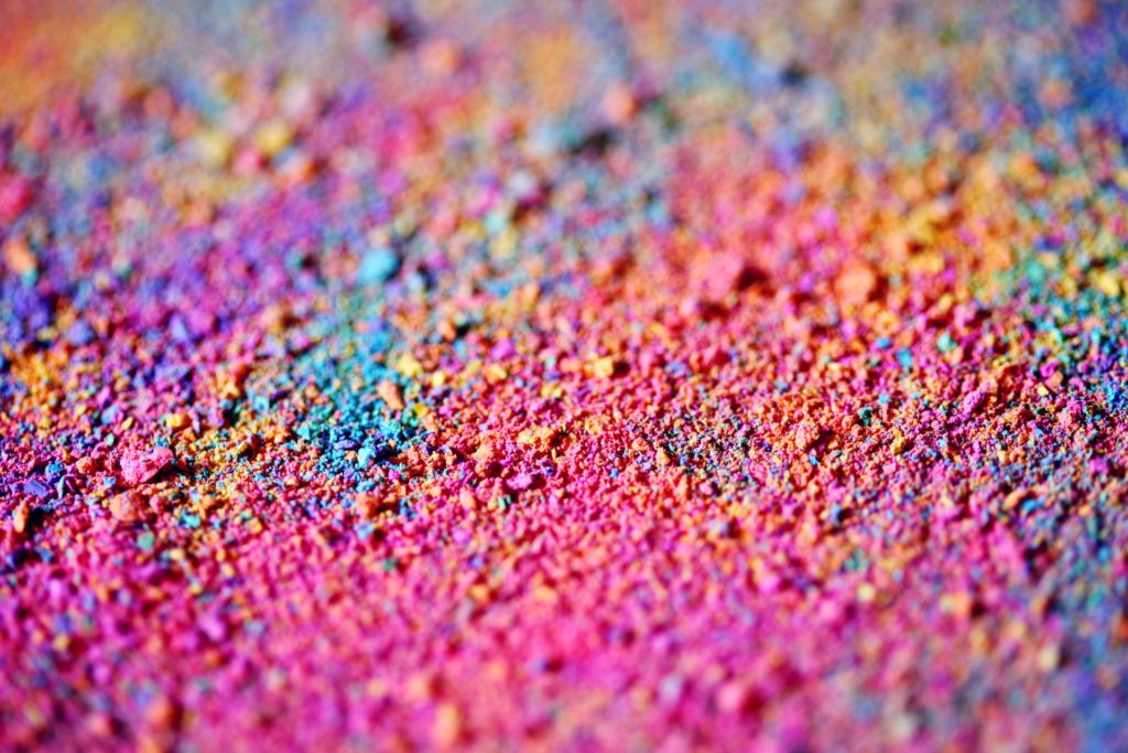 Image of bright, multi-colored chalk dust to tie in with the brand building example of Hagoromo chalk