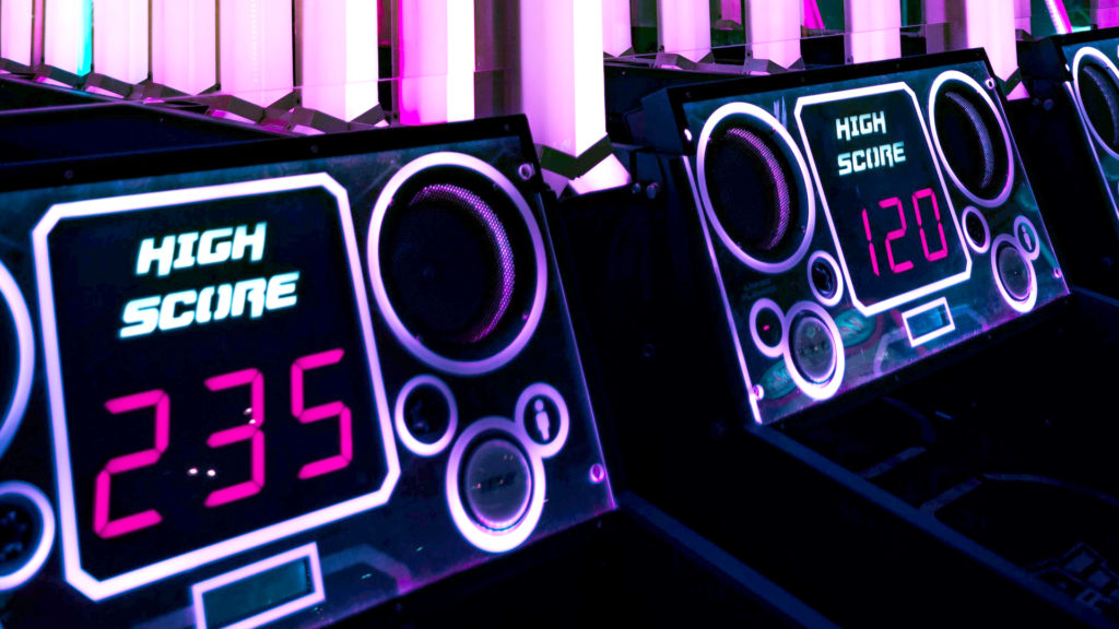 Marketing data analytics were the topic during a presentation of full funnel B2B marketing summit: this image is of two neon-backlit high score display screens