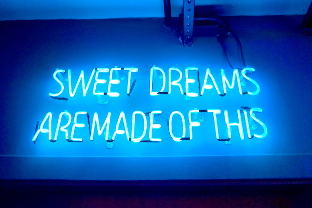 neon sign saying sweet dreams are made of this. this article is about the marketer's sweet dream of how to improve SEO rankings and land at #1