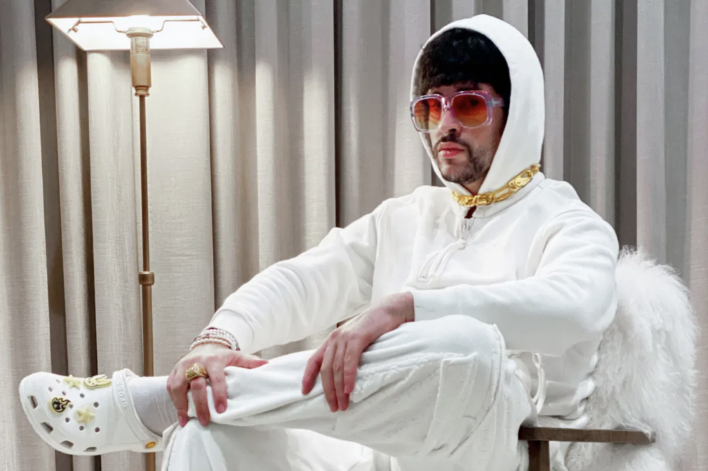 reggaeton rapper bad bunny wearing white crocs in an ad marking his partnership with the brand in an effort to better connect with gen-z and millennial consumers