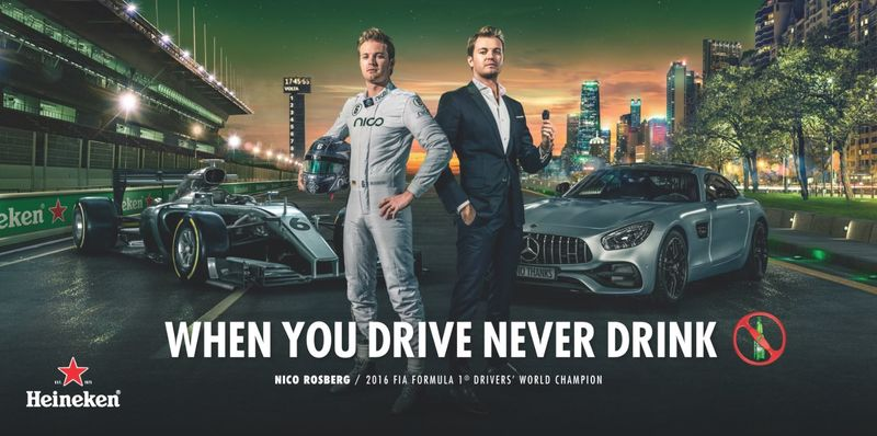example of ad for heineken millennial marketing strategy with image of an f1 racing figure in front of luxury cars and headline when you drive never drink