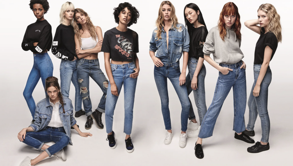 an ad depicting a group of young models wearing topshop brand fashion with the goal of targeting gen-z and millennial marketing demographic