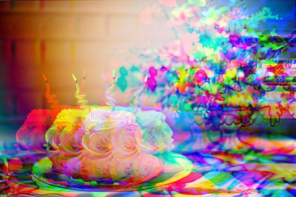 distorted, pixelated image of a cake with candles and flowers in a vase resting on a table as cover art for the article on how to improve b2b advertising strategy for more conversions, lead generation and ROI