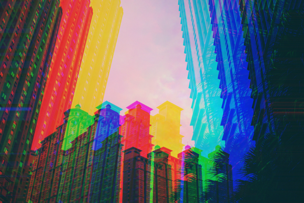 image of multi-colored buildings against a pink hue sky as banner image for article on virtual community building strategy - lessons, tips and advice