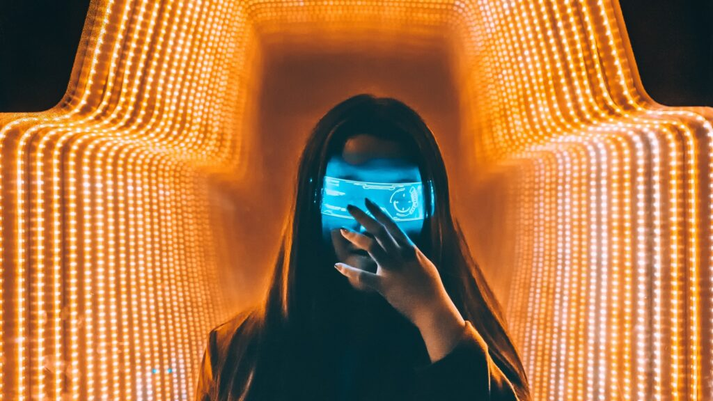 silhouette of woman standing in front of neon yellow and white lights with a neon blue holographic image over her eyes as the header image for the article about how visual bias in marketing and advertising campaigns impacts perceptions