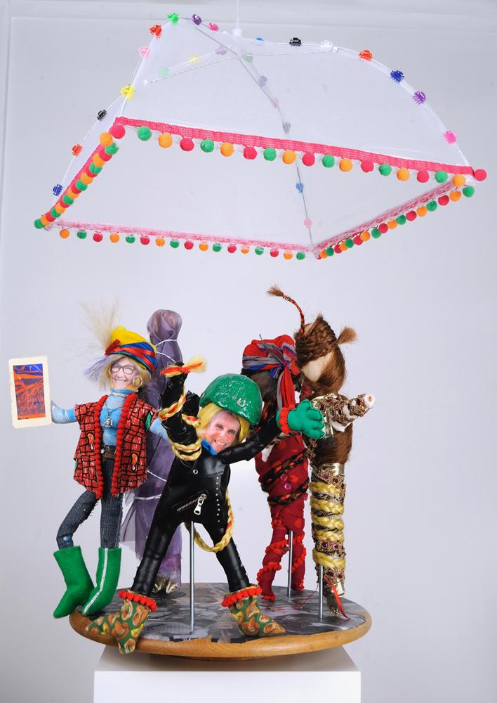 "Carousel of Life Sticks, fabric, mixed media, 14"" tall, $295 each."
