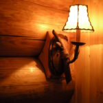 Installed sconse on log wall