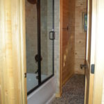 Basement bath, pebble floor
