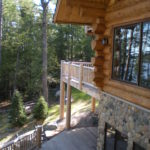 Lakeside deck, log railing