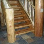 5-29-2009 half log stairway, log railing
