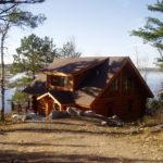 Cedar Log Lake Cabin set in hill side