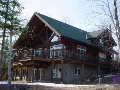Dark stained cedar log home