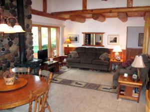 Living room stone douglas fir & cedar logs
