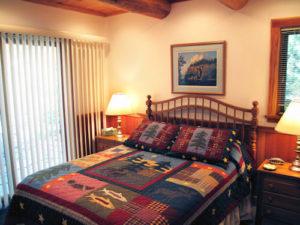 bedroom with drywall doug fir cedar logs