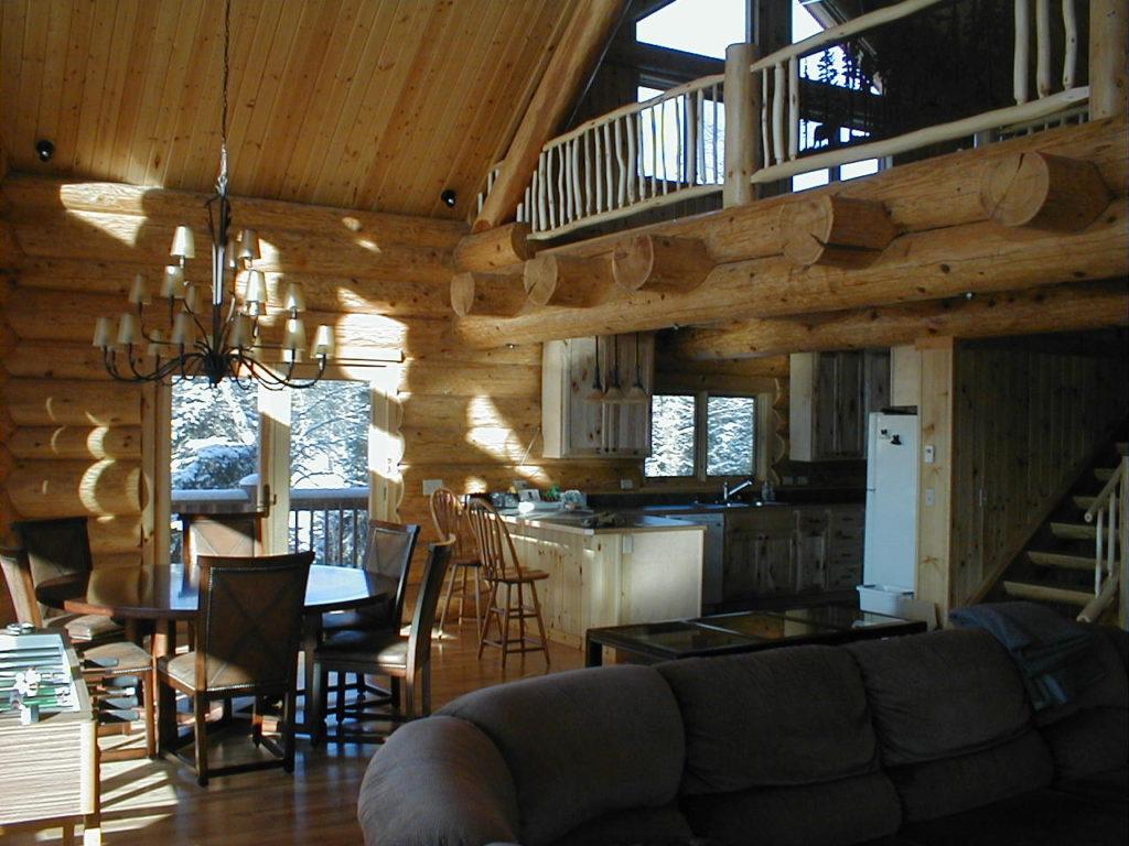 Great room lake wall cedar log home