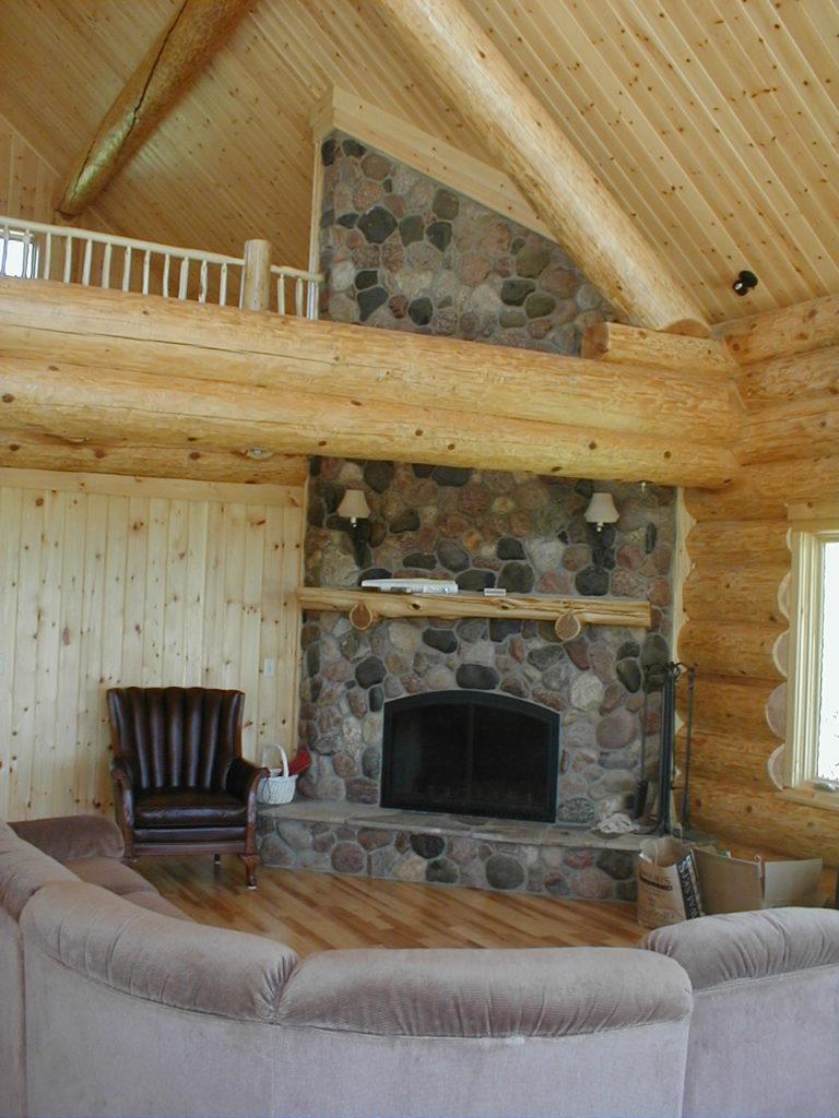 Log home stone fireplace