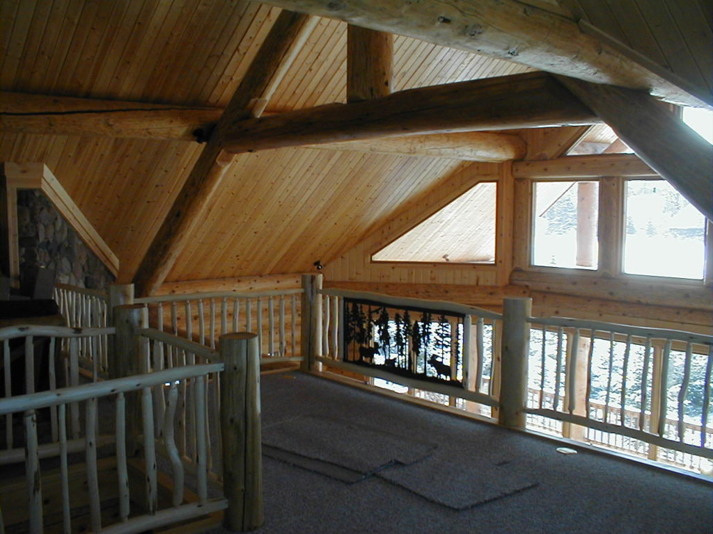 Loft area with log truss and beams