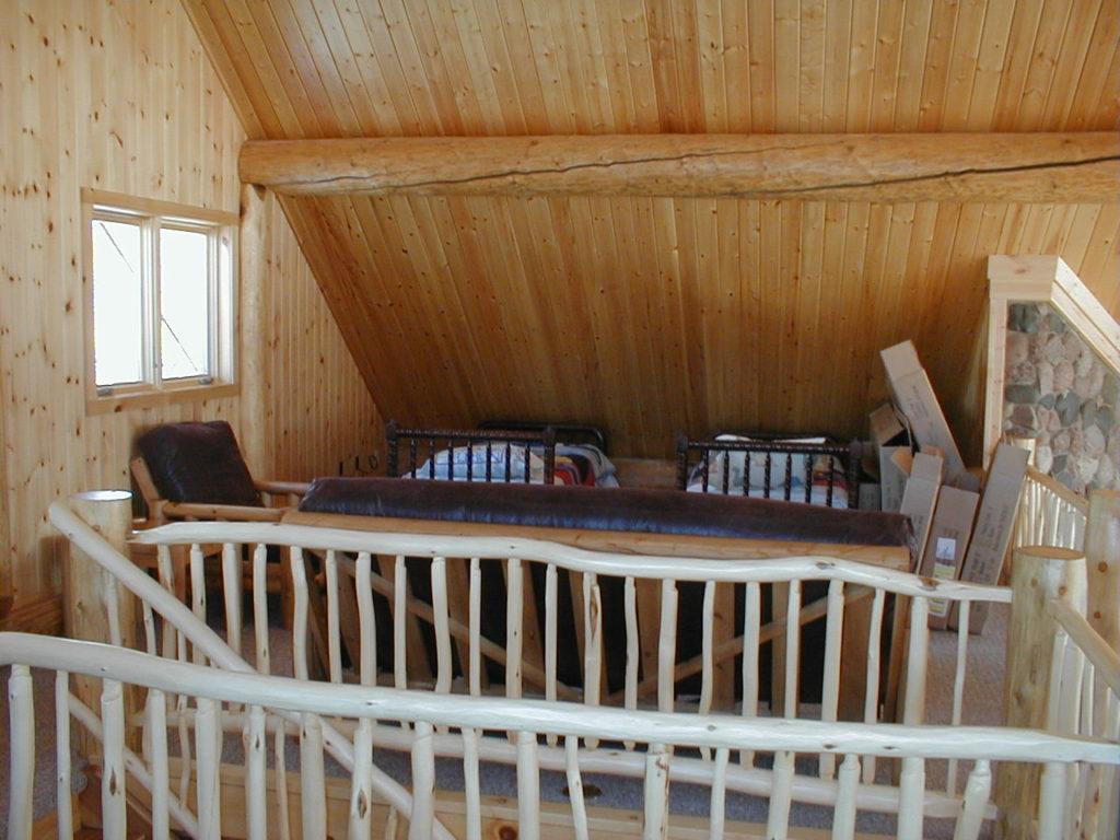 Lof stairs, log railing