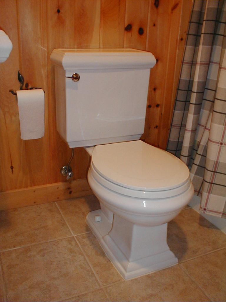 Bathroom stool pine walls tile floor