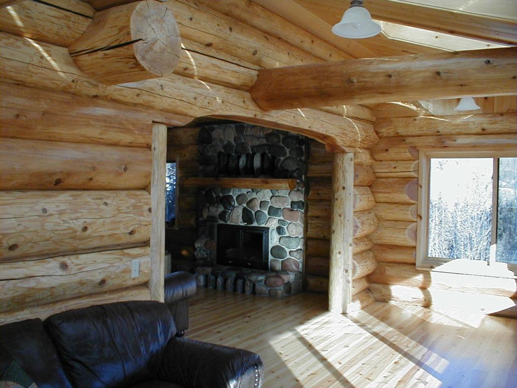 Cedar logs, archway, stone fireplace