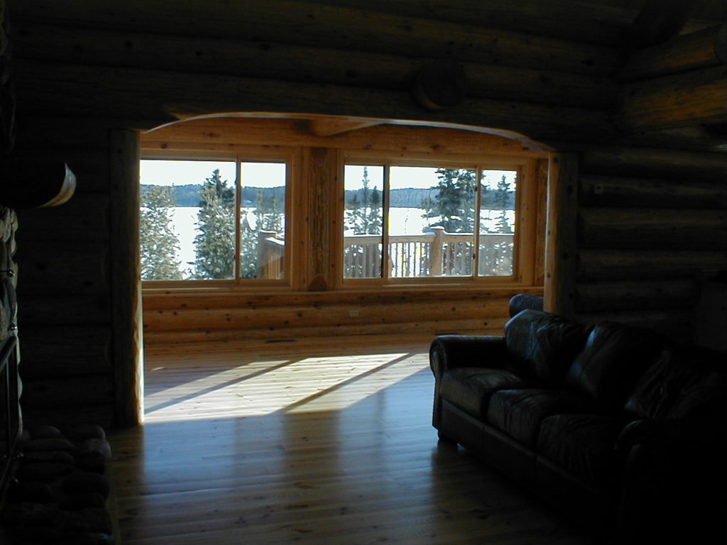 Log archway, windows to the lake view