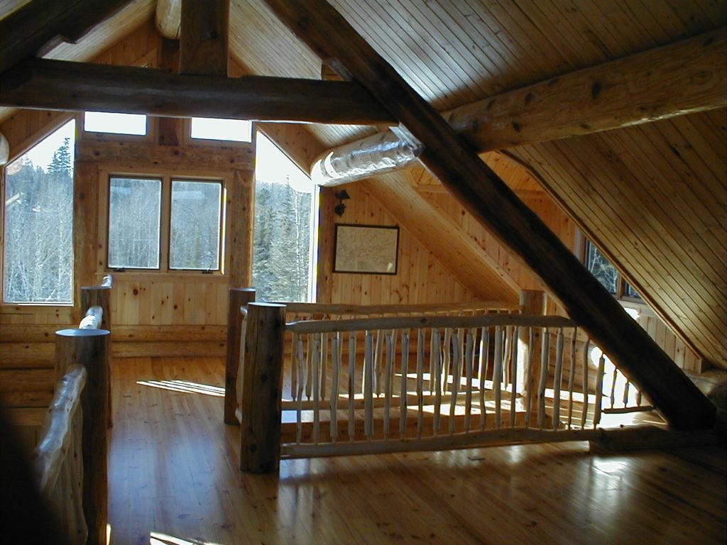 Log cabin loft, aspen log railing, pine floor