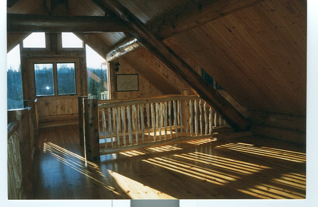 Log cabin loft, light streaming, log railings
