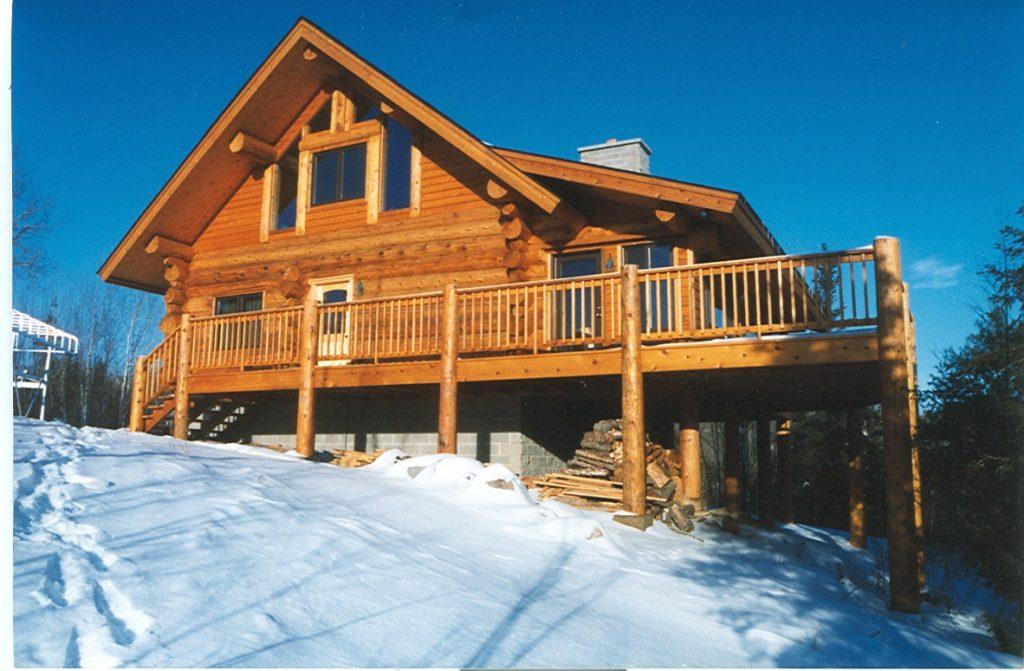 Red cedar log cabin, snow, sunshine