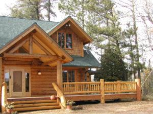 Cedar Logs and railing, dormers, main entry