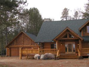 Cedar log home, entry and garage