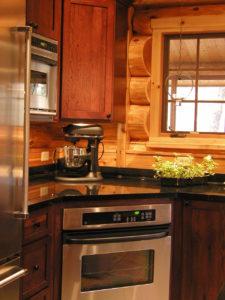 Kitchen area, range, cedar log home