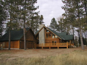 Cedar log home, stone chimney