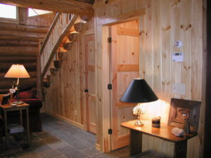 Stairs to loft in log home