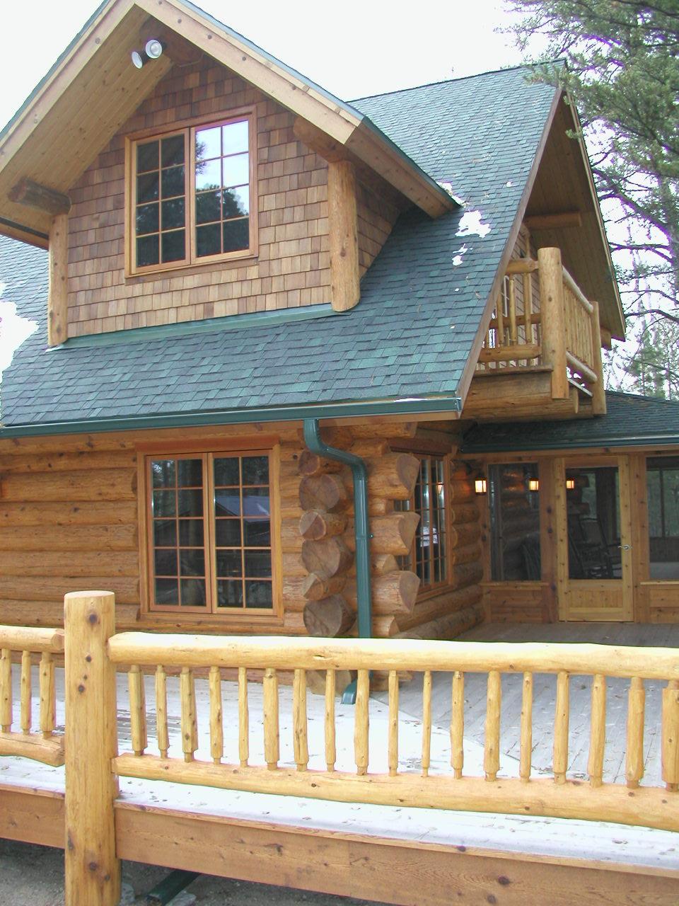 Cedar Logs and railing, dormers and screen porch