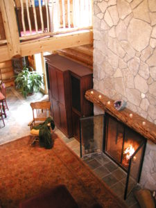 Looking down from loft at fireplace and great room