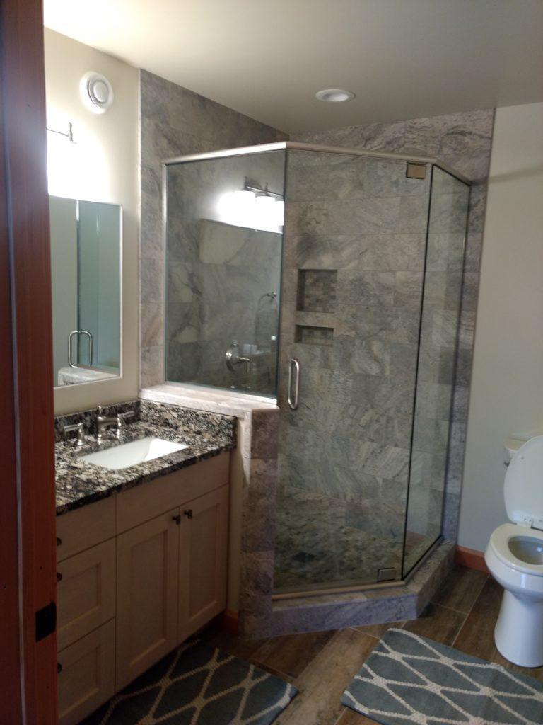 Glass, tile and granite bathroom