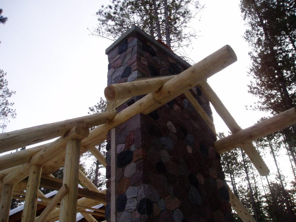 Perlins and rock fireplace, gazebo under construction