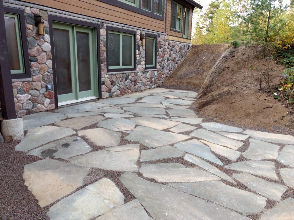 exterior stone on lakeside walkout