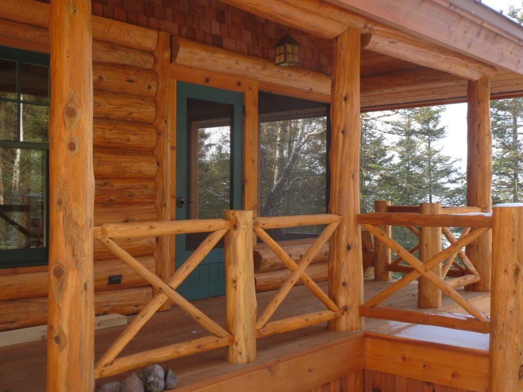 Porch entry and old style log railing
