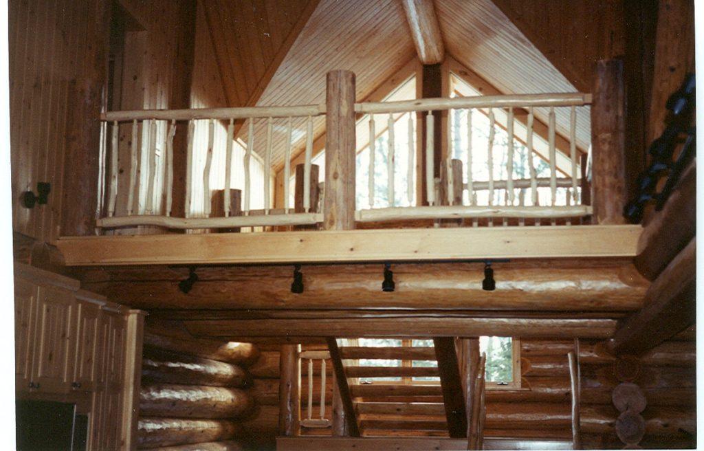 Loft windows, stairs, log home