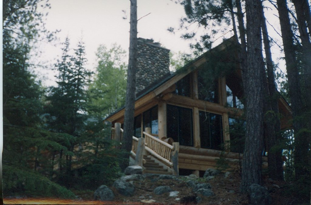 Log home lakeside sun room
