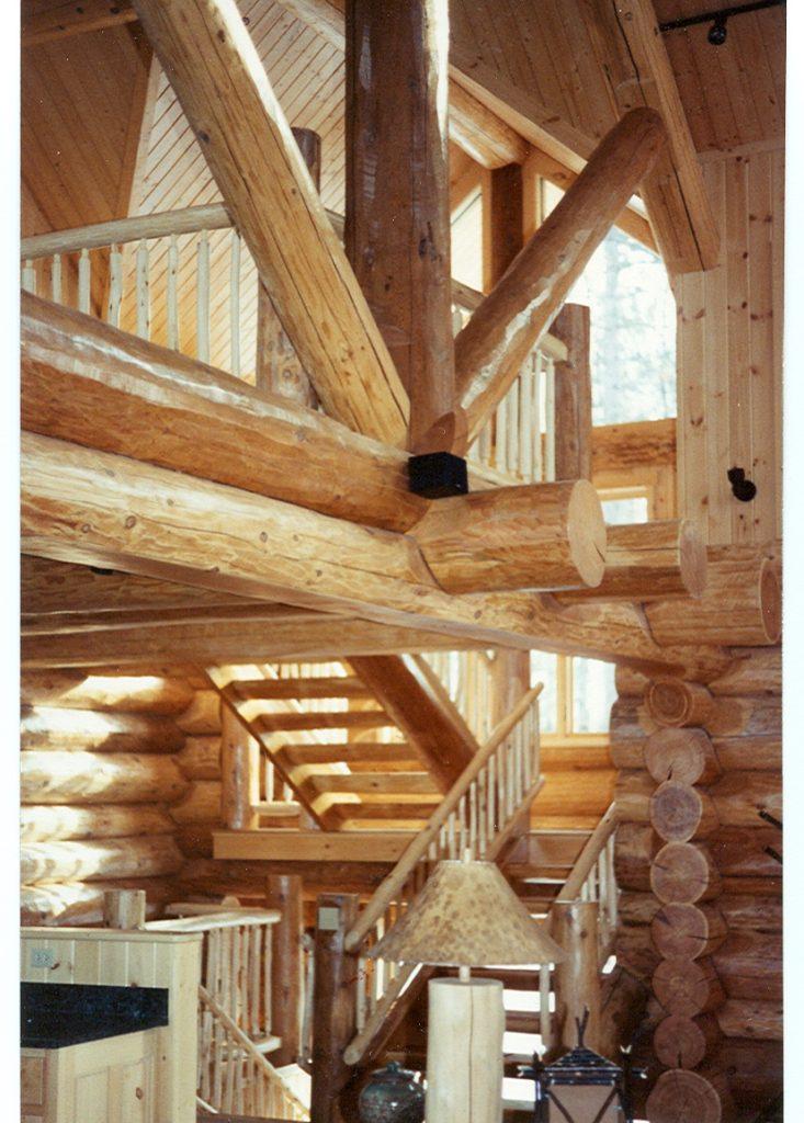 Stairway in log home