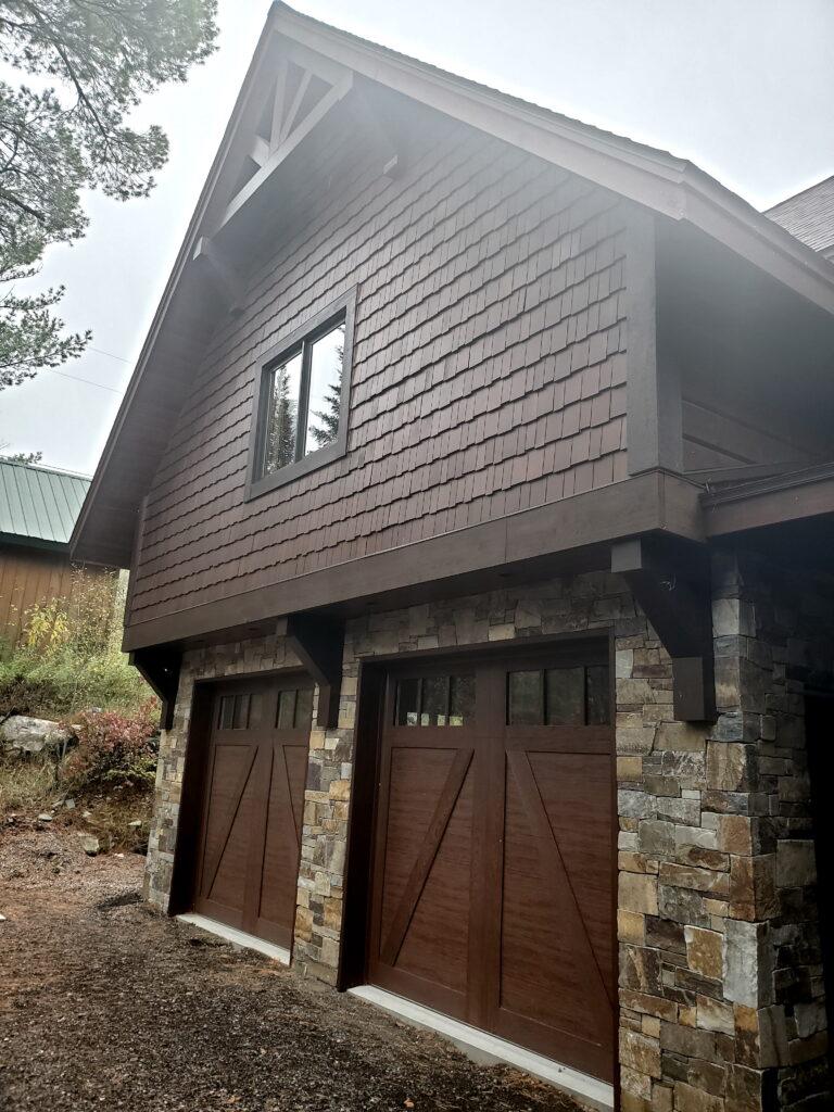 Garage doors on custom home by huisman Concepts