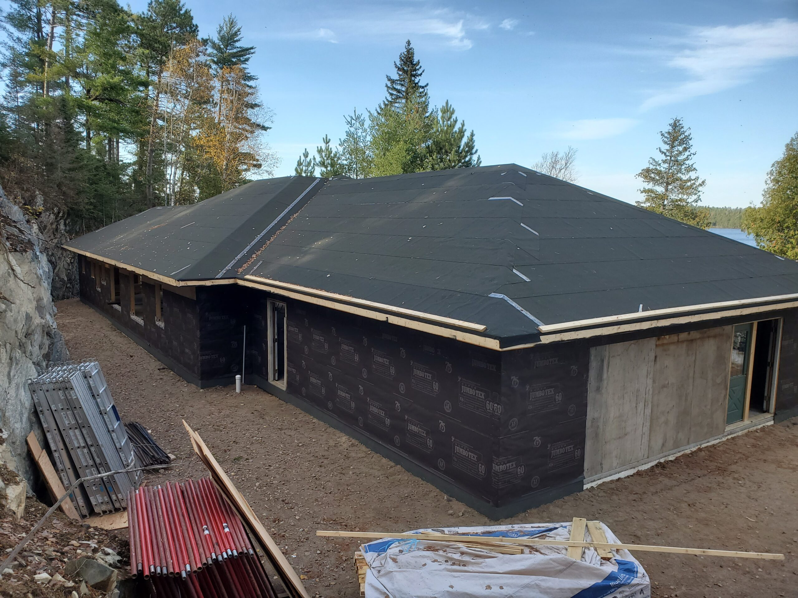 Custom home by Huiosman Concepts dried in before the snow October 2019